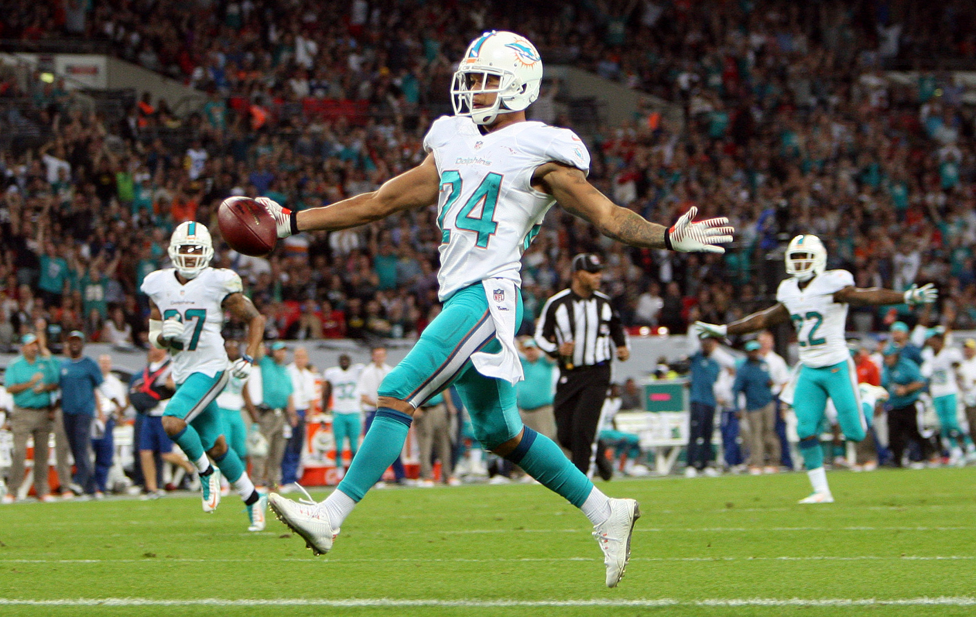 Miami Dolphins at Oakland Raiders NFL 28/09/14 Wembley Stadium,London. Cortland Finnegan celebrates scoring a touchdown. Pic Nicky Hayes/NFL UK