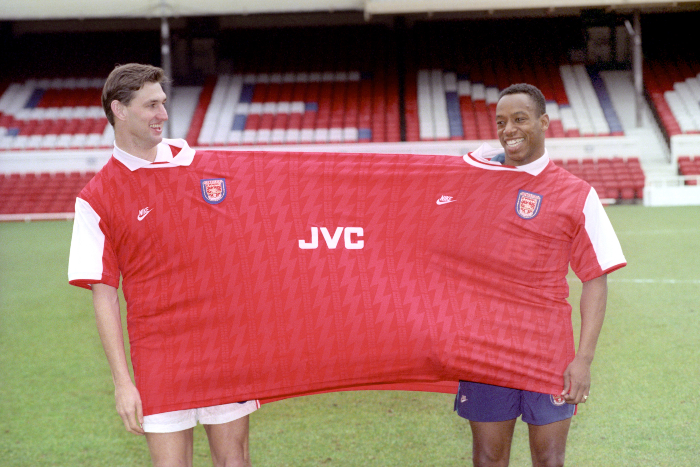 ARSENAL FOOTBALLERS TONY ADAMS (L) & IAN WRIGHT STRETCH A POINT WITH THE NEW KIT PRODUCED BY NIKE TO BE WORN NEXT SEASON.